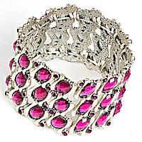 Браслет широкий, инкрустирован декоративными камнями малинового цвета