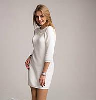 Красивое женское вязаное платье-туника молочного цвета