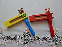 Деревянные игрушки трещетки