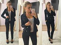 Стильный женский костюм-двойка: пиджак на пуговицах и приталенные брюки, черный