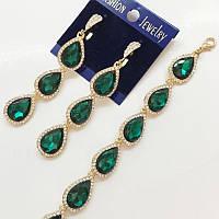 Набор украшений серьги и браслетик с роскошными зелеными кристаллами в золоте