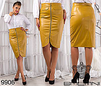 Эффектная женская юбка по колено из эко кожи