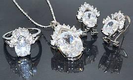 Набор: кулон на цепочке, серьги и кольцо 17 р. Цвет: серебряный. Камни: белый циркон и россыпь белых фианитов.