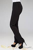 Стильные деловые брюки черного цвета со вставкой и стразами