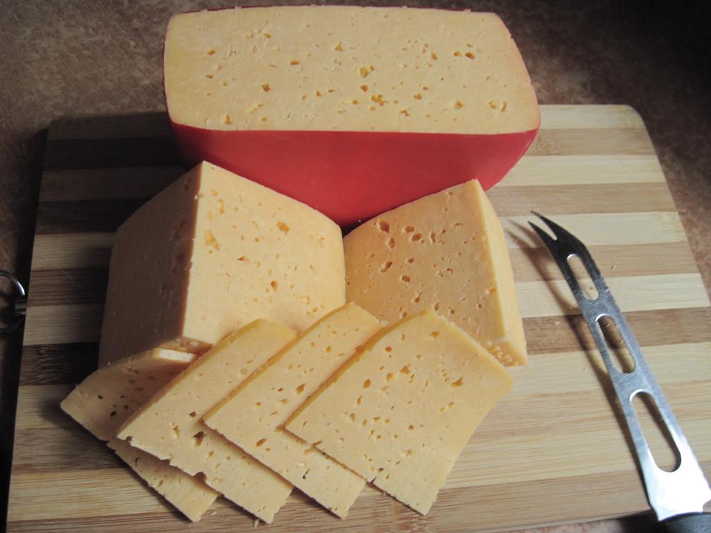 """Наш """"Домашний"""" сыр с топлёным молоко после вызревания в пакете , в течение 2 недель"""