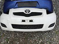 Передний бампер Toyota Yaris 2005-11