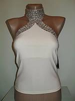 Женская блузка с пайетками и открытой спиной