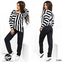 Спортивный костюм: кофта и штаны. Кофта асимметричной длины в полоску.
