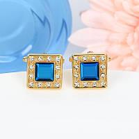 Мужские запонки с синим камнем золотистой окантовке, фото 1