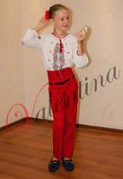 Красные брюки с завышенной талией и декоративными пуговицами