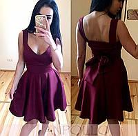 Женское платье с бантом на спине