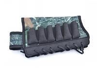 Этот охотничий аксессуар из комбинированных материалов является бюджетным решением патронташа открытого типа с