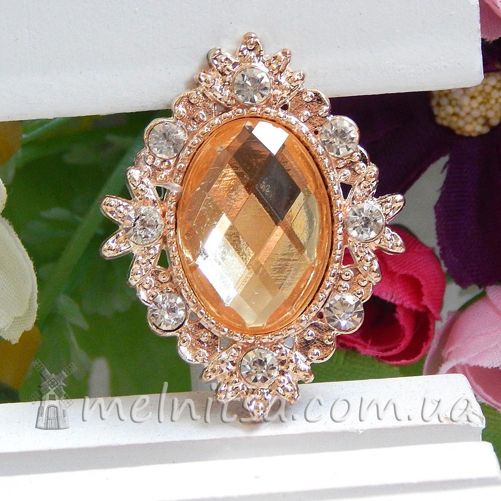 Камень в золотистой оправе со стразами 3 см, шампань