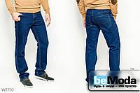 Стильные джинсы Luvans прямого кроя с карманами по бокам и сзади и стильной контрастной выстрочкой синие
