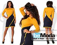 Модное женское платье оригинального кроя с контрастными ассиметричными вставками горчичное