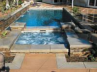Бассейн с джакуззи облицованный резанным камнем