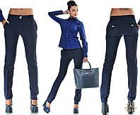 Женские классические брюки со стрелками и клапанами сзади