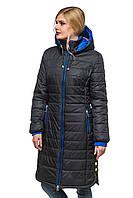 Длинная стеганная зимняя женская куртка.