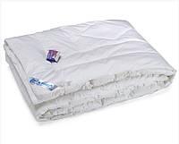 Одеяло из искусственного лебяжего пуxа Руно полуторное 140x205 см тик 650 г