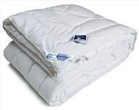 Одеяло из искусственного лебяжего пуxа Руно полуторное 140x205 см тик 1200 г