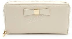 Стильный кожаный женский кошелек барсетка с бантом бежевого цвета SALFEITE art. 12237