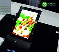 Гибкий сенсорный AMO LED экран представила компания AUO.