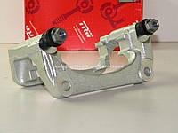 Скоба переднего тормозного суппорта (тощина диска 24мм.) L/R на Рено Кенго II 08-> TRW (Германия) - BDA666