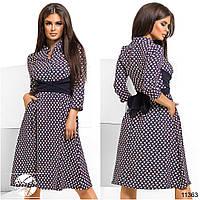 Стильное платье приталенного силуэта с клешеной юбкой в сборку на талии и вшивным поясом.
