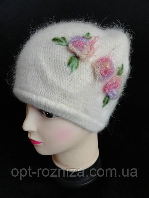 Женские вязанные зимние шапки