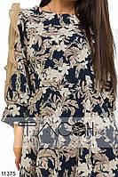 Платье с клешеной юбкой, декорированное контрастным цветочным принтом и вставками из шифона на рукавах.