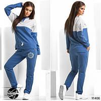 Спортивный костюм: кофта и штаны. Кофта асимметричной длины с завязками, декорирована контрастной вставкой.