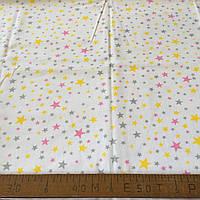 Фланель (байка) с розовыми, желтыми и серыми звездочками на белом фоне