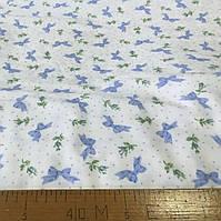 Фланель (байка) с голубыми бантиками и горошками на белом фоне, фото 1