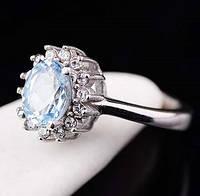 Женское серебряное кольцо (голубой топаз, фианиты)