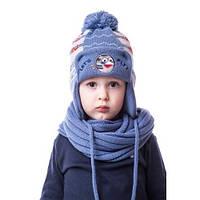 Модная детская шапка-ушанка на мальчика с помпоном