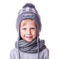 Теплая детская шапочка на мальчика в клеточку с помпоном