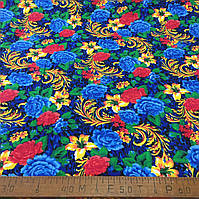 Фланель (байка) ш.150 красные, желтые и голубые цветы на синем фоне