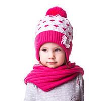 Теплая вязаная детская шапочка в ромбик на девочку с бантиком