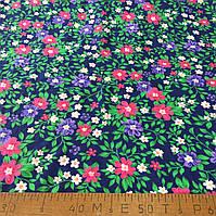 Фланель (байка) ш.150 розовые и фиолетовые цветы на темно-синем фоне