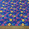 Фланель (байка) ш.150 розовые и желтые цветы на синем фоне
