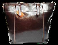 Женская стильная кожаная сумка коричневого цвета трапецией