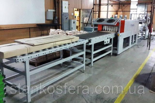 Термоусадочная упаковочная машина б/у УМТ-1000АК для упаковки продукции и деталей мебели, 2013 г.