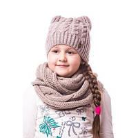 Детская вязаная шапка на девочку однотонная