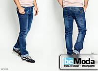 Элегантные зауженные джинсы Mardoc с изящными отворотами, лёгкими декоративными потёртостями и лейбами синие