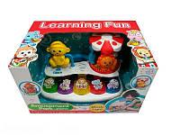 Игрушка для ребенка музыкальная с животными