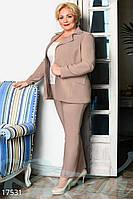 Строгий женский брючный костюм большого размера.