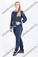 Стильный трикотажный спортивный костюм синего цвета в крапинку
