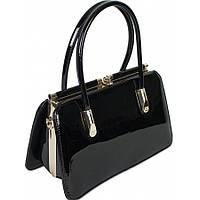 Женская сумка из лаковой кожи черного цвета