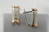 Оригинальное кольцо из серебра с фианитами и золотом