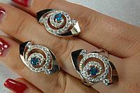 Комплект женских ювелирных украшений - кольцо и серьги